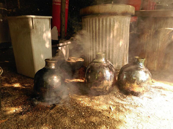 Raku Pottery from the burning sawdust. Photograph by Ruth Gillett.